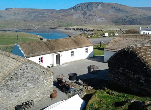 Folk Village with view of Glen Head, Glencolmcille, County Donegal